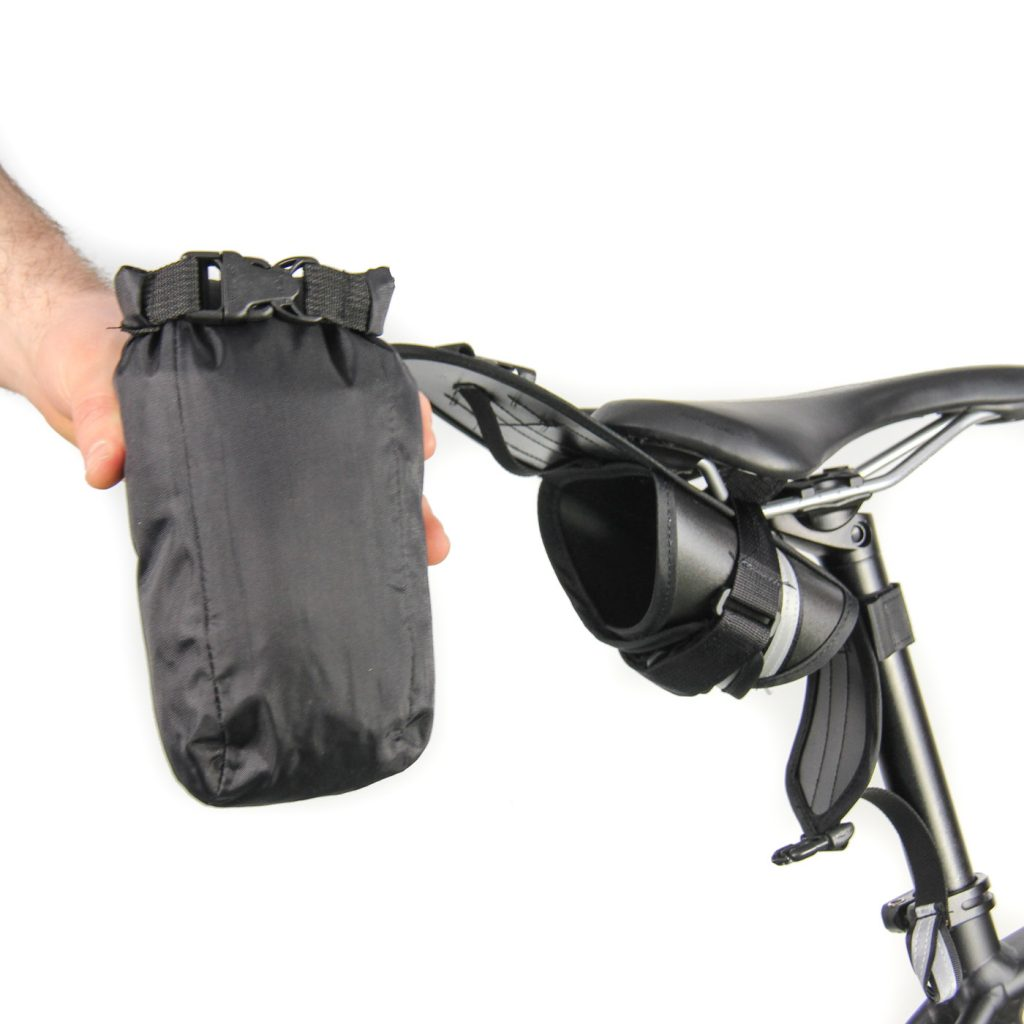 The bag and content is easily removed while the outer shell remains in place.