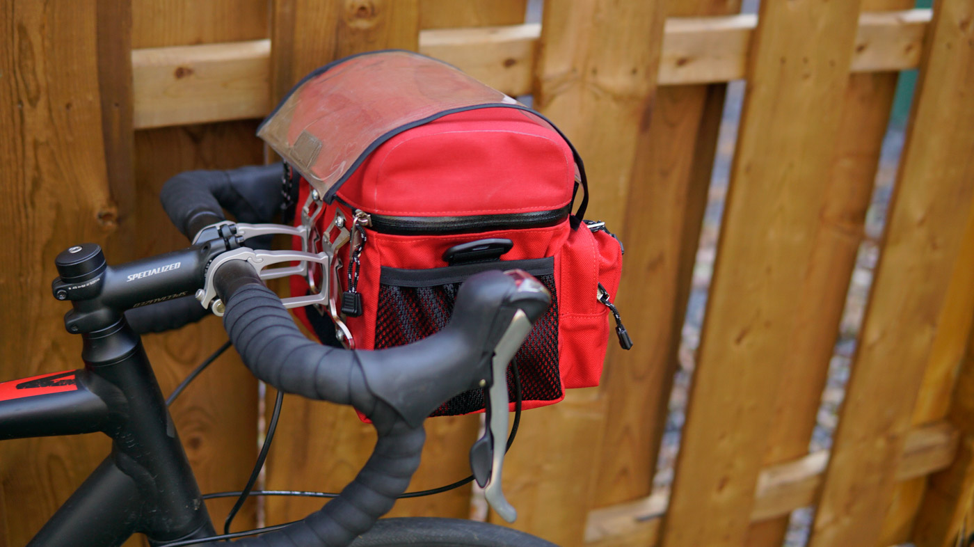 Small handlebar bag red on road bike