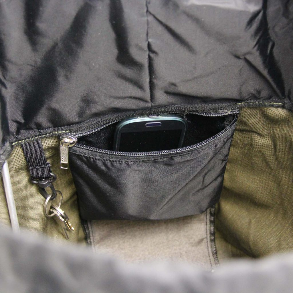 Key hook and zippered pocket ocated inside the main compartment of the pannier