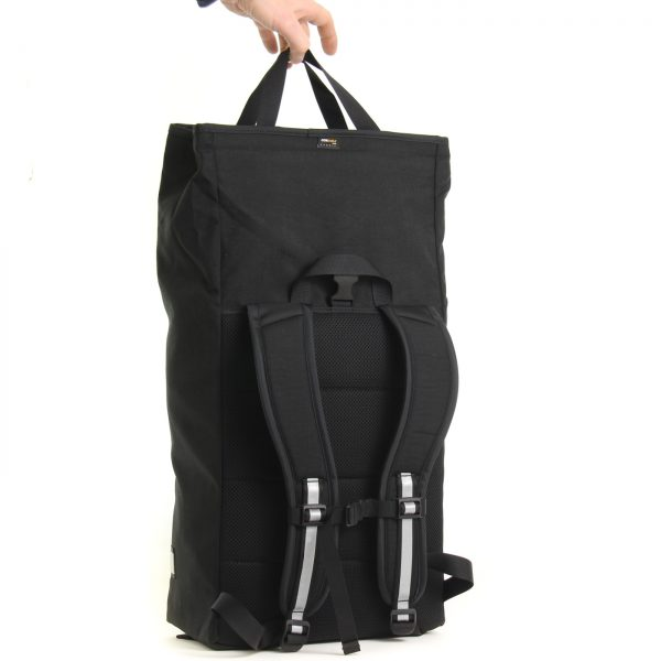 Signature D bike backpack with shopping bag style carry handle.