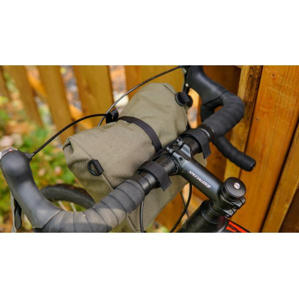 The Signature BB handlebar bag attaches to the handlebar with the adjustable velcro straps.
