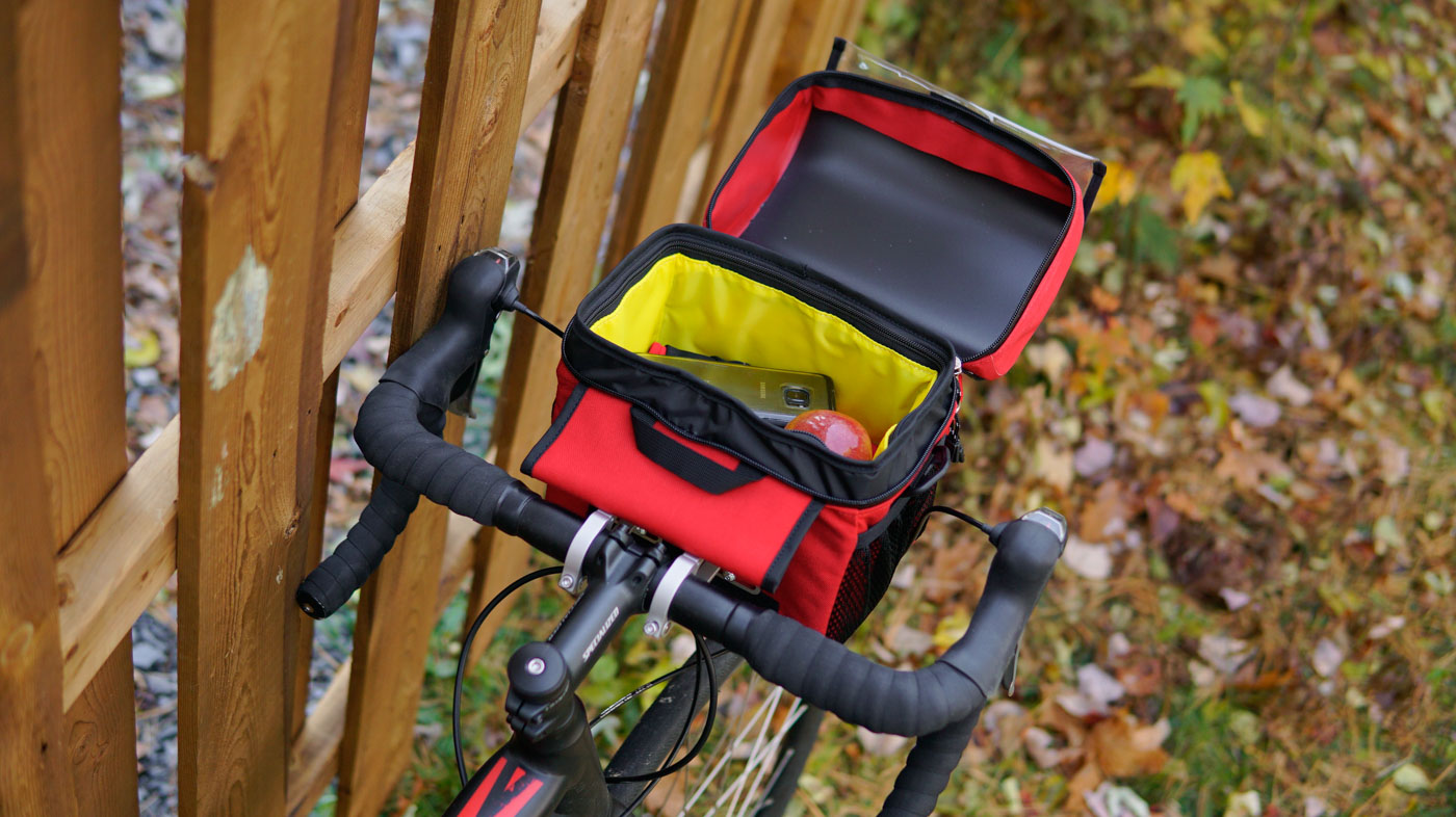 Arkel waterproof classic handlebar bag open to see content of main compartment
