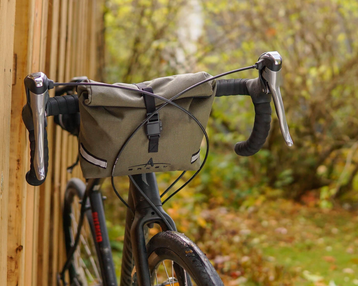 Waterproof handlebar bag Signature BB in the olive color installed on a gravel bike