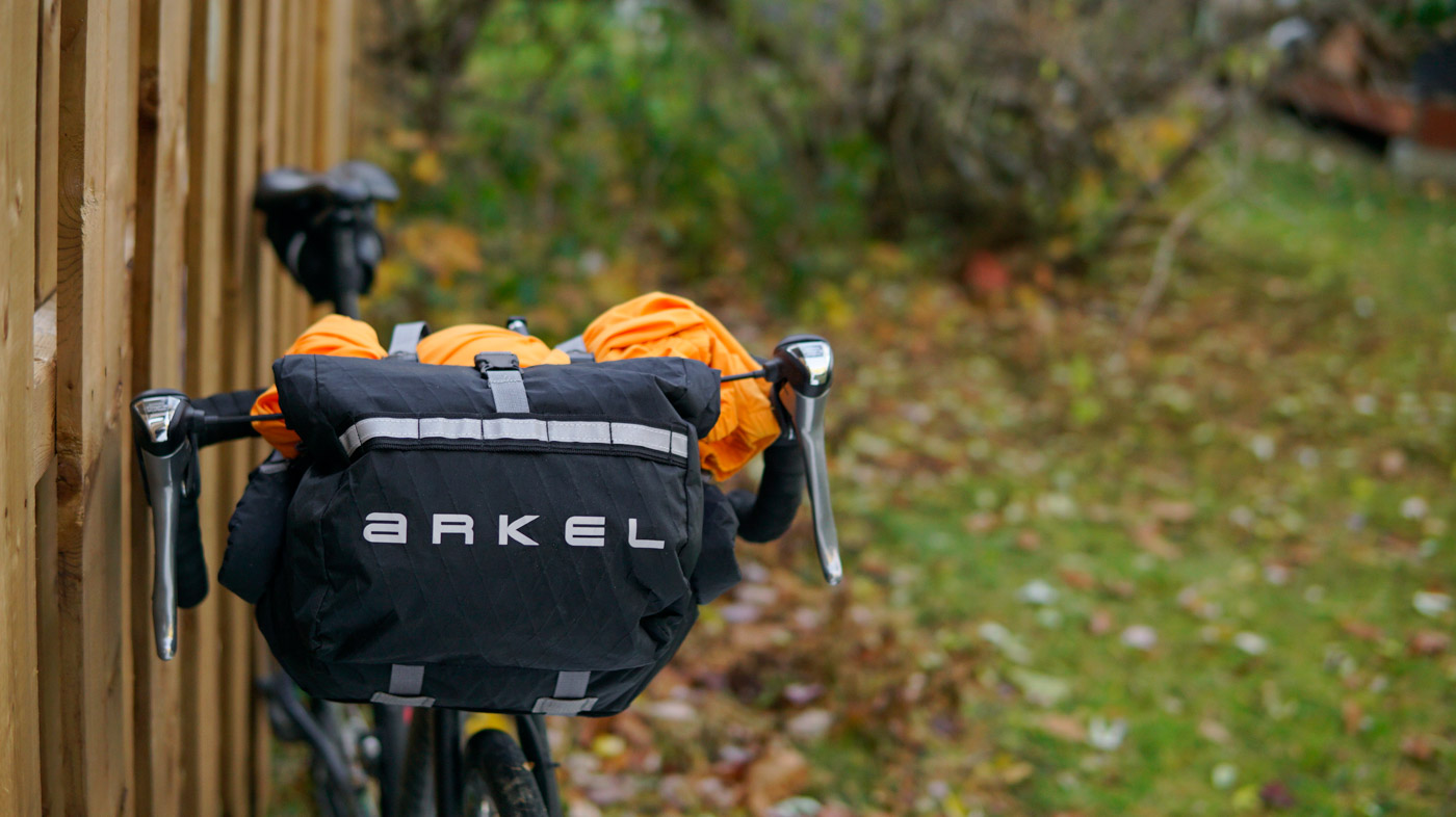 Arkel Rollpacker 15 handlebar bag or front roll installed on a gravel bike with drop bars.
