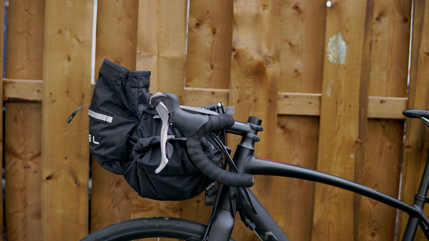 Arkel Rollpacker 15 handlebar bag with front pocket open.