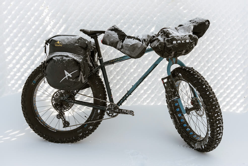 Bicycle in the snow with bike bags