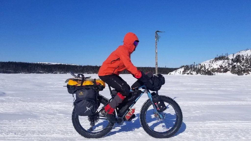 man on fatbike riding in the snow