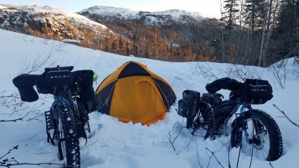 Camping tent with two fatbikes in winter